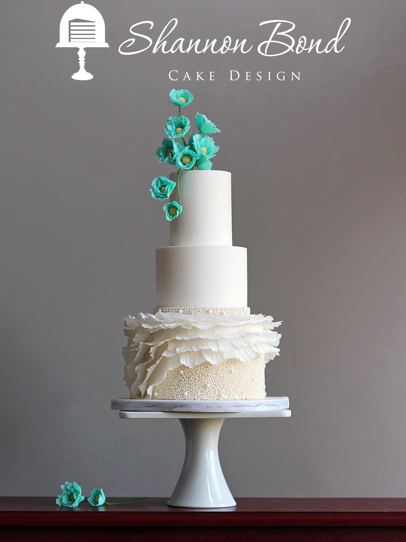 White wedding cake with turquoise sugar flowers