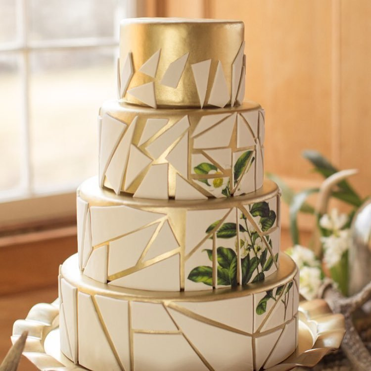 Ivory and gold geometric patterned fondant wedding cake