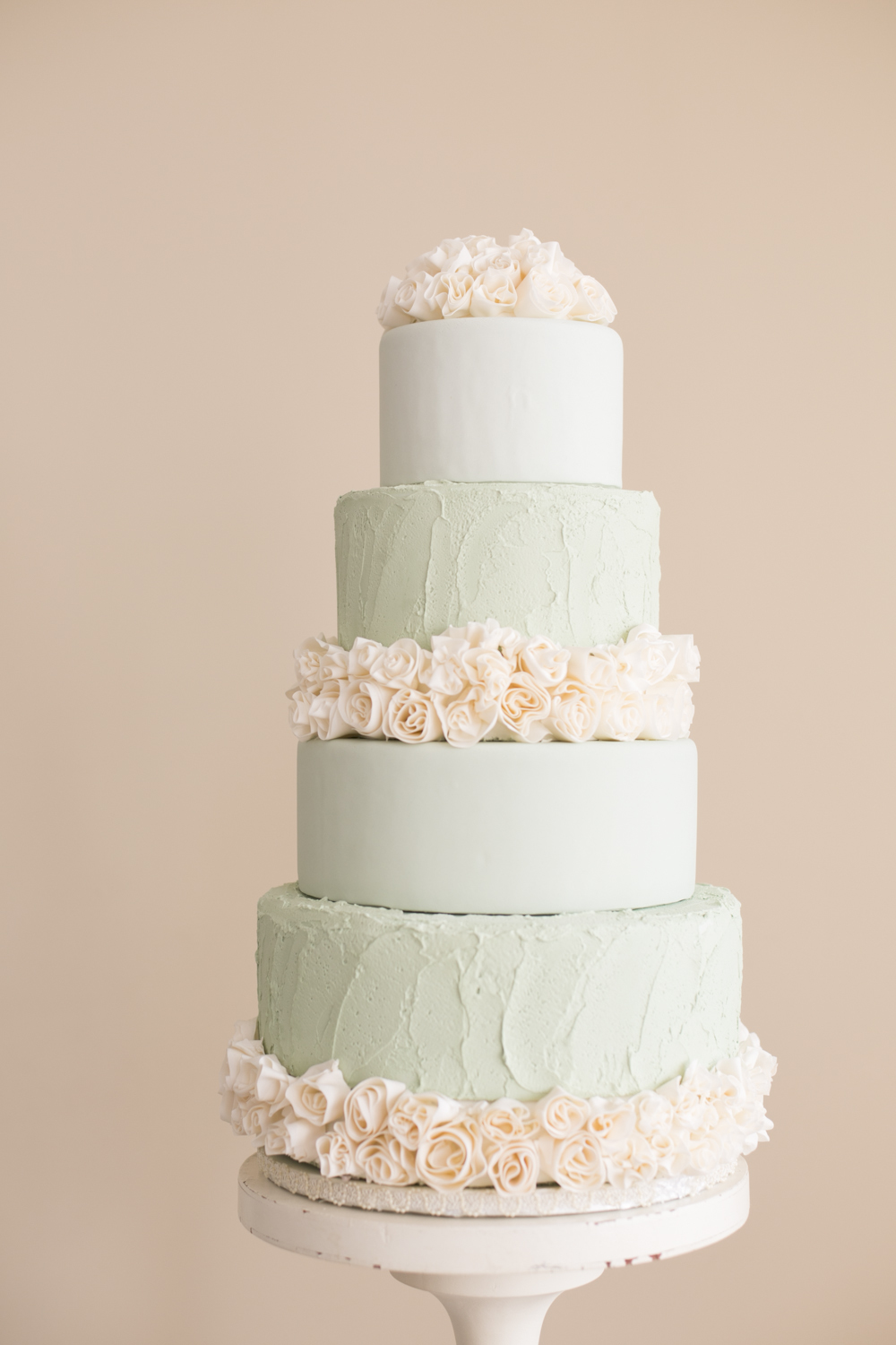 Pastel green and baby pink fondant wedding