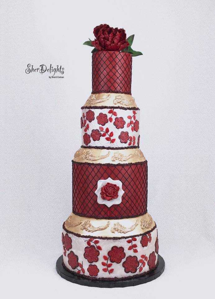 Burgundy with gold fondant wedding cake