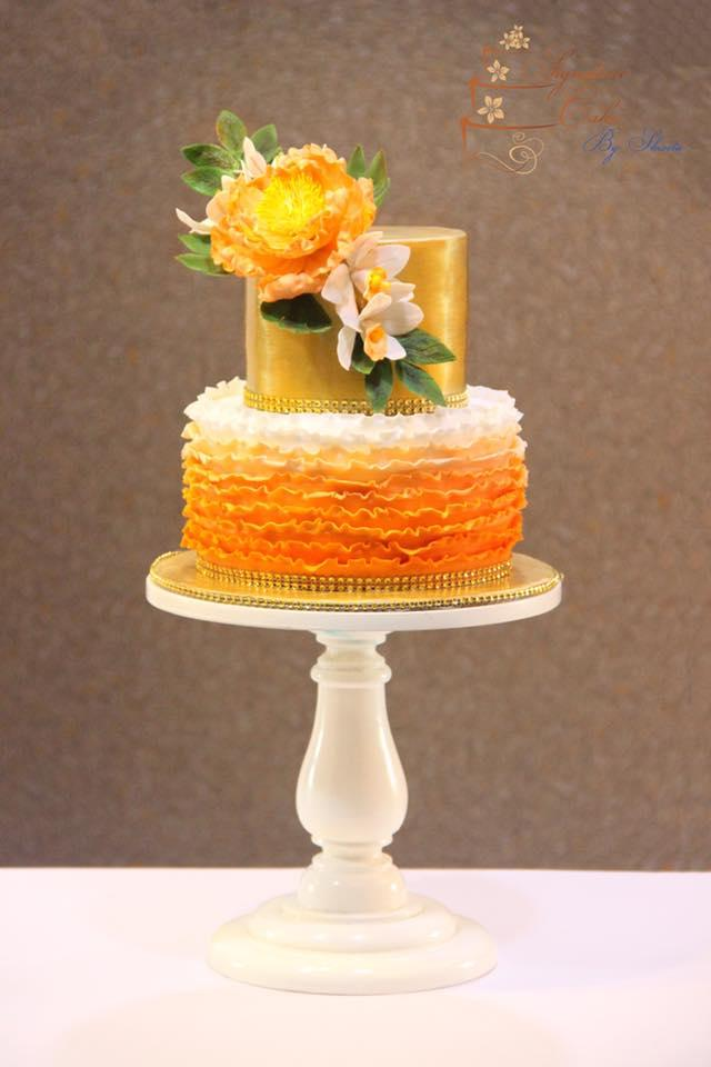 Orange ombre fondant wedding cake with gold