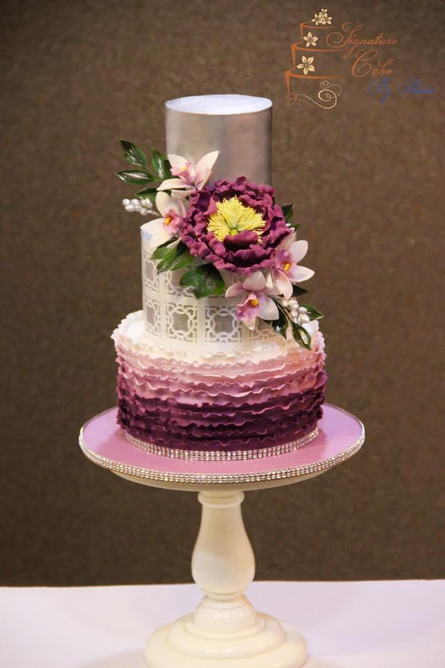 Purple Ombre ruffle wedding cake with silver