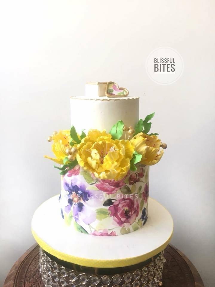 white fondant cake with yellow sugar flowers