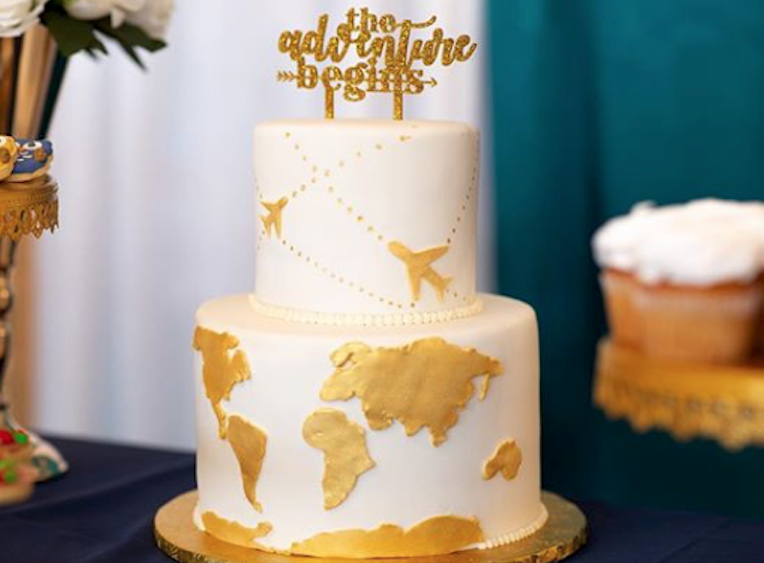 White and gold fondant traveling cake