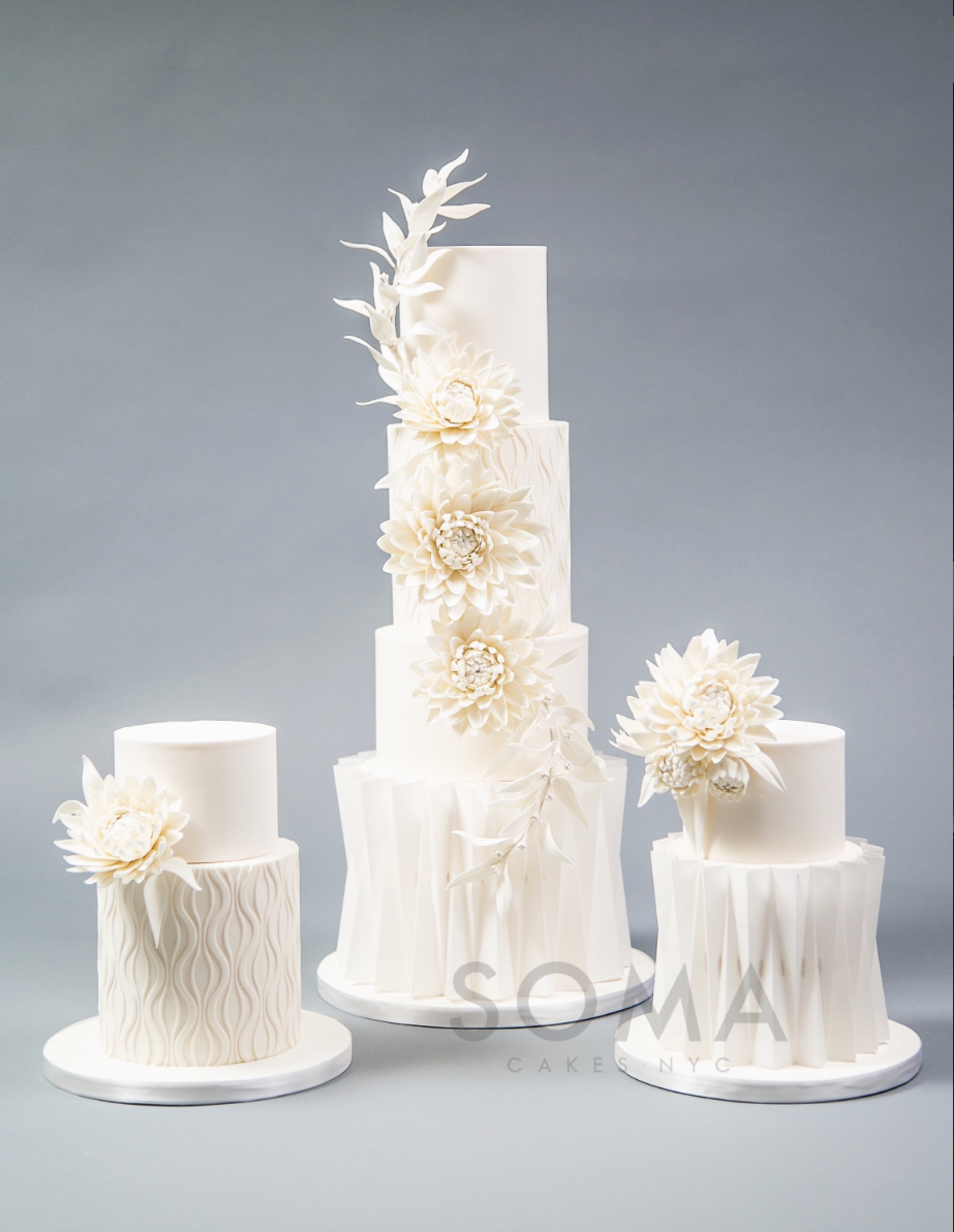 White on white fondant wedding cake