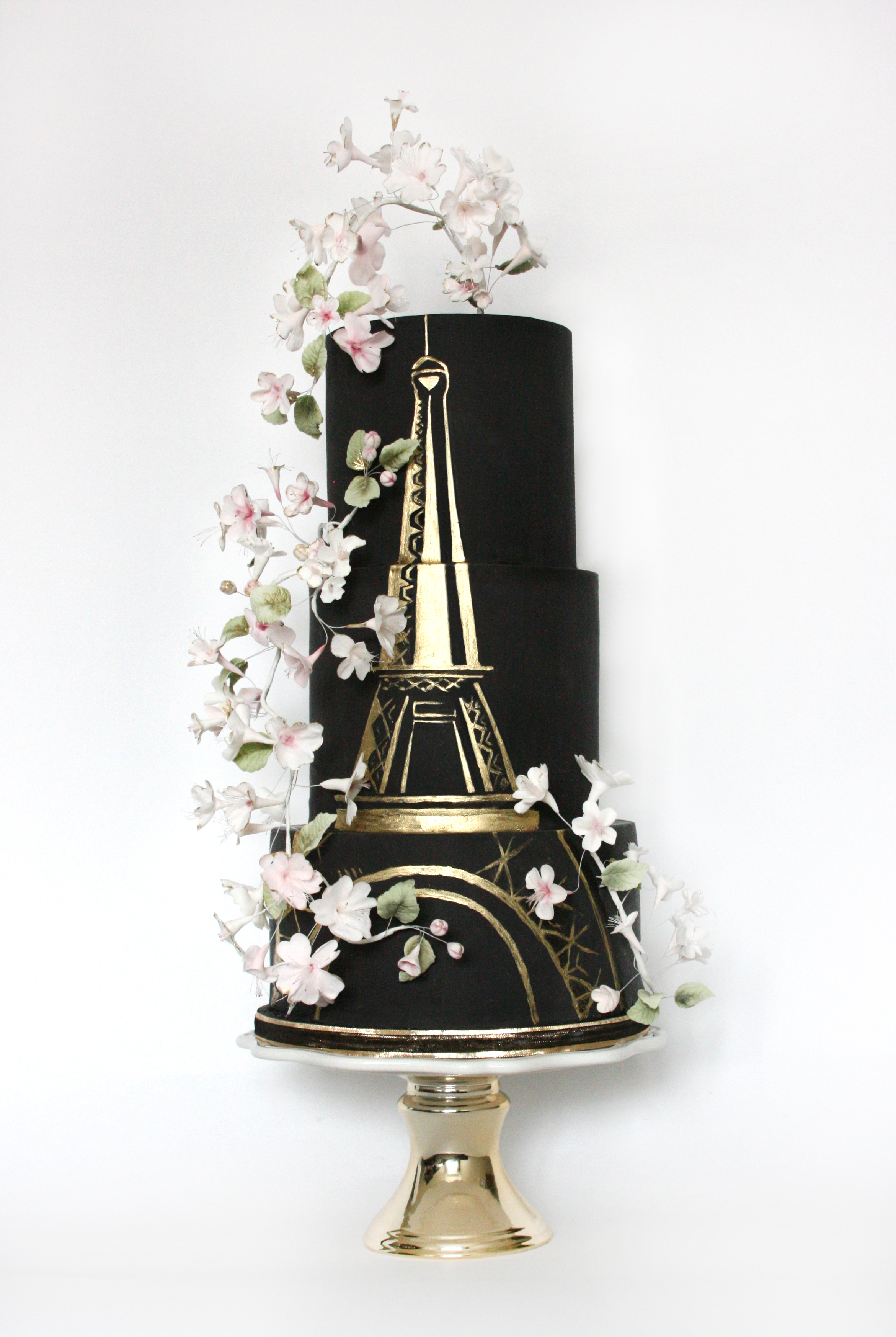 Black and gold parisian themed wedding cake