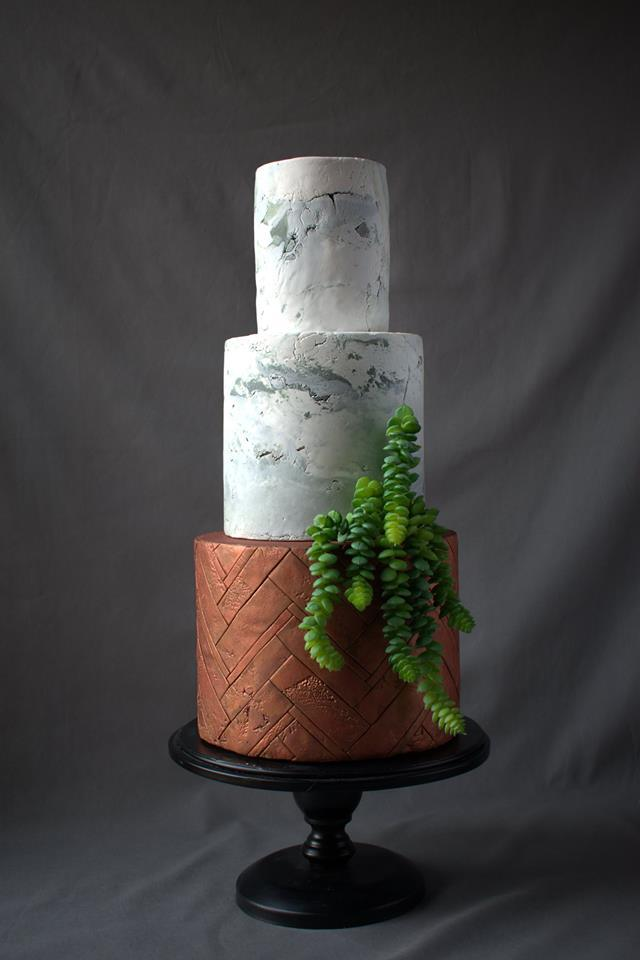Gray and copper wedding cake with sugar leaves