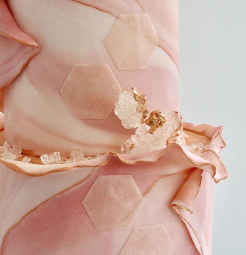 Light pink and rose gold fondant wedding cake