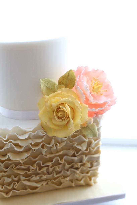 White & yellow ruffle wedding cake