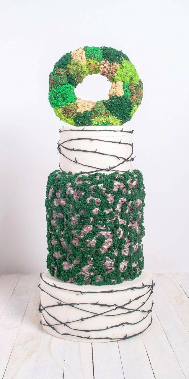 Shades of green and white spring wedding cake with moss