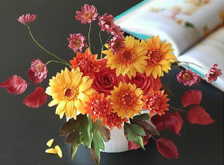 Orange and yellow bouquet of sugar flowers
