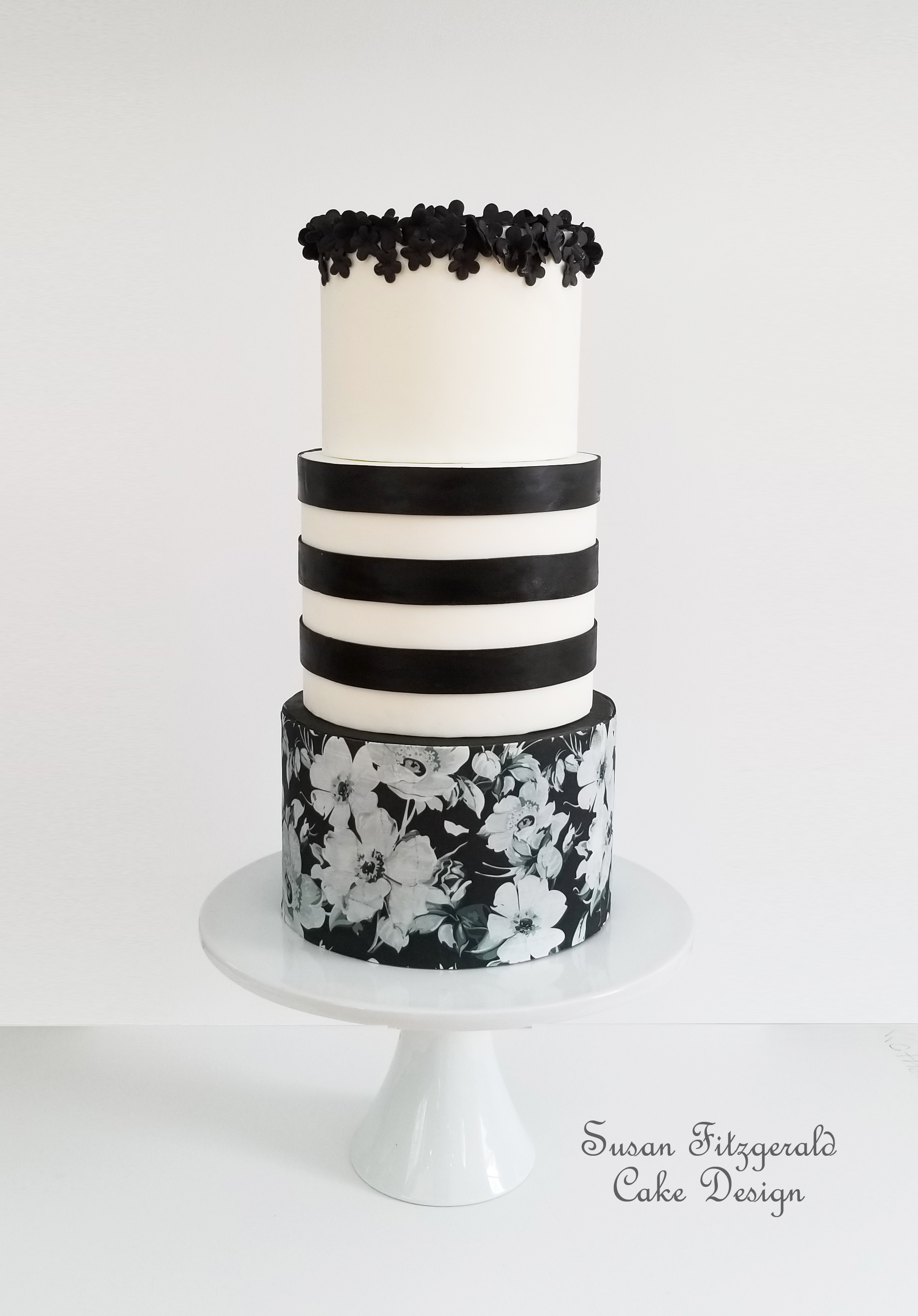 Black and white fondant cake with black sugar flowers