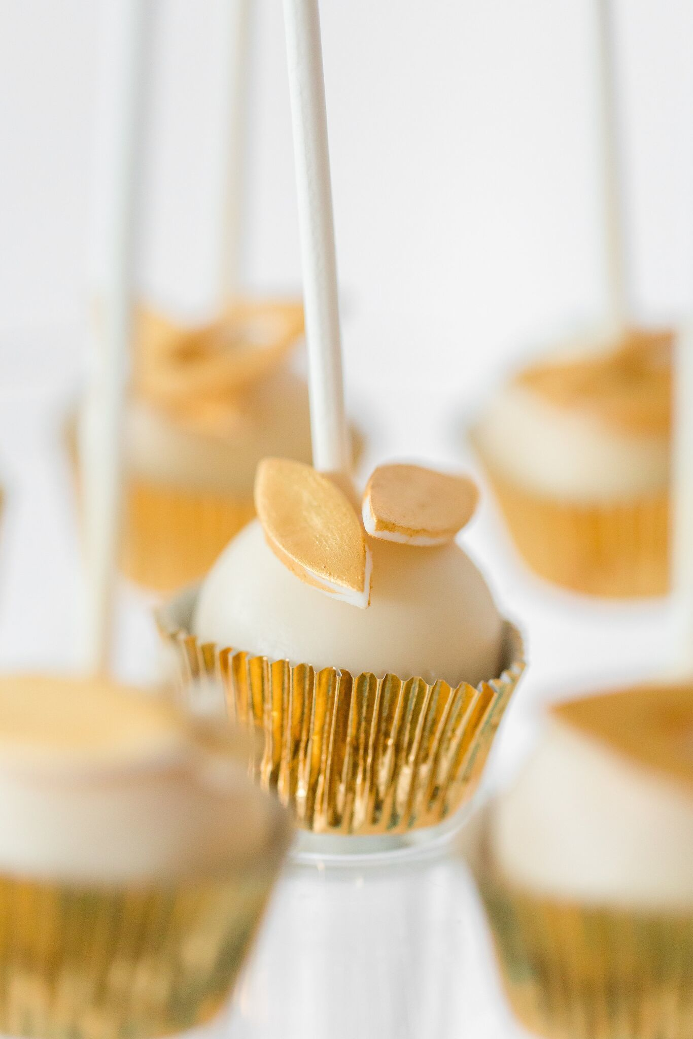 White and gold cake pops