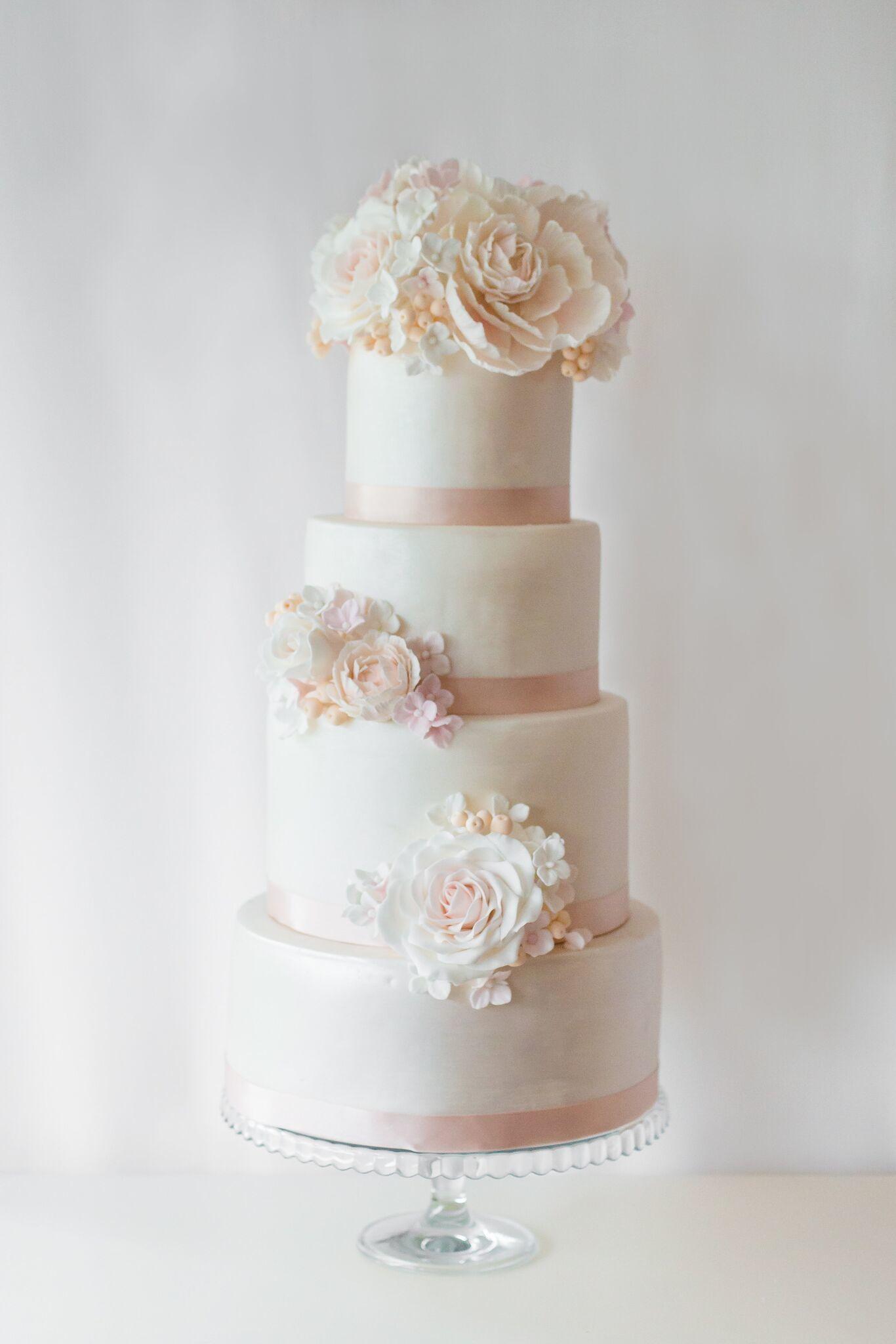 Ivory fondant wedding cake with white sugar flowers