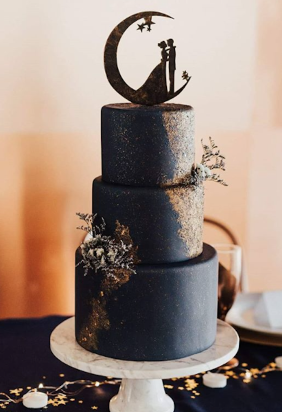 Celestial inspired black fondant wedding cake