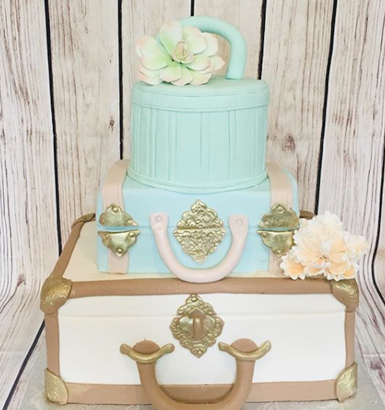 Pastel colored suitcase wedding cake