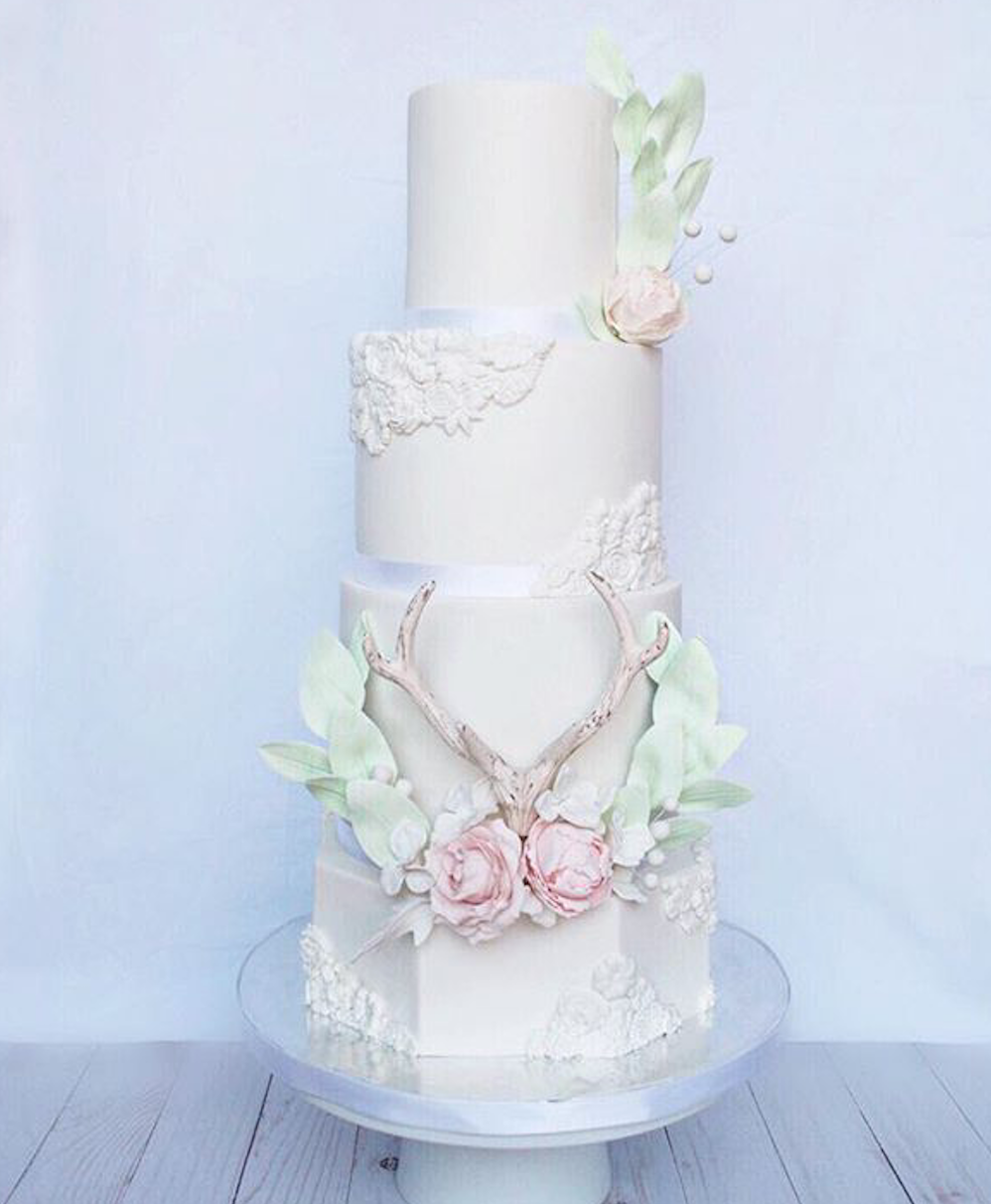 White boho antler fondant wedding cake