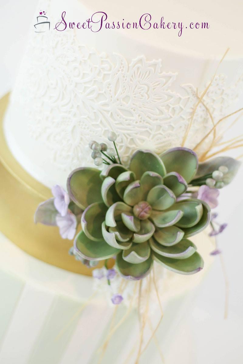 white fondant wedding cake with succulents