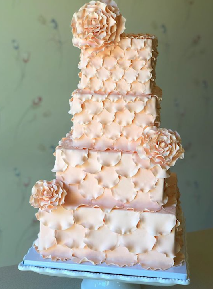 Peach scalloped fondant wedding cake