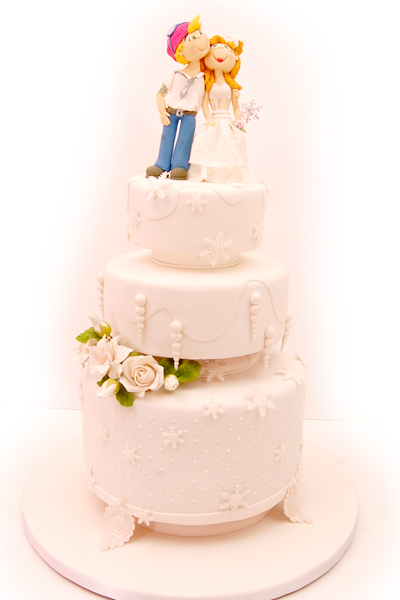 Light Pink Wedding Cake with Couple Topper