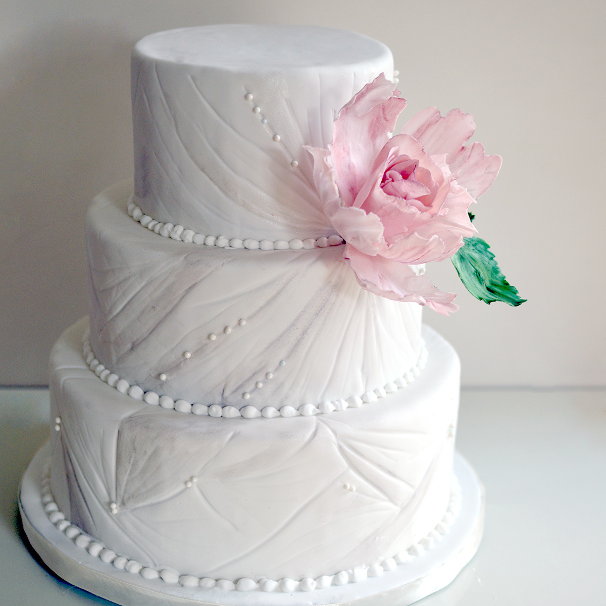 Quilted textured white wedding cake