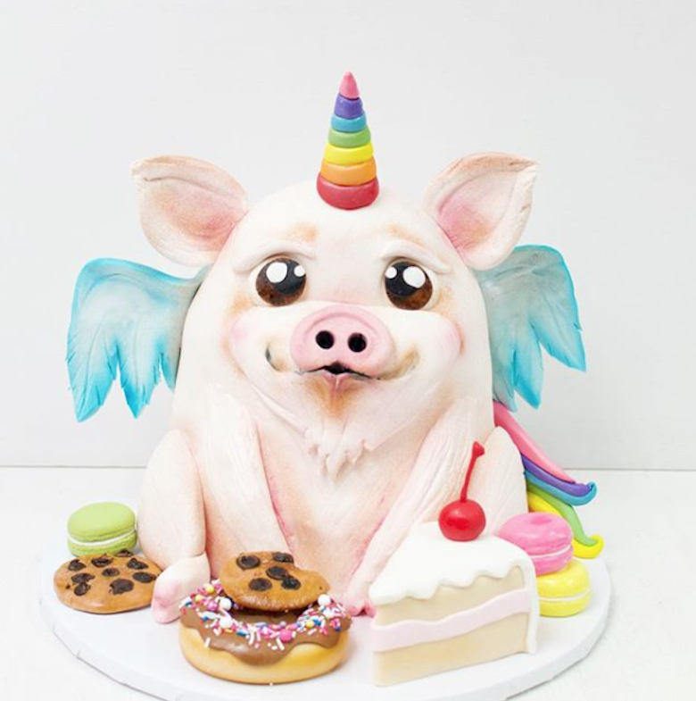 Light pink pig with unicorn wings fondant bust cake