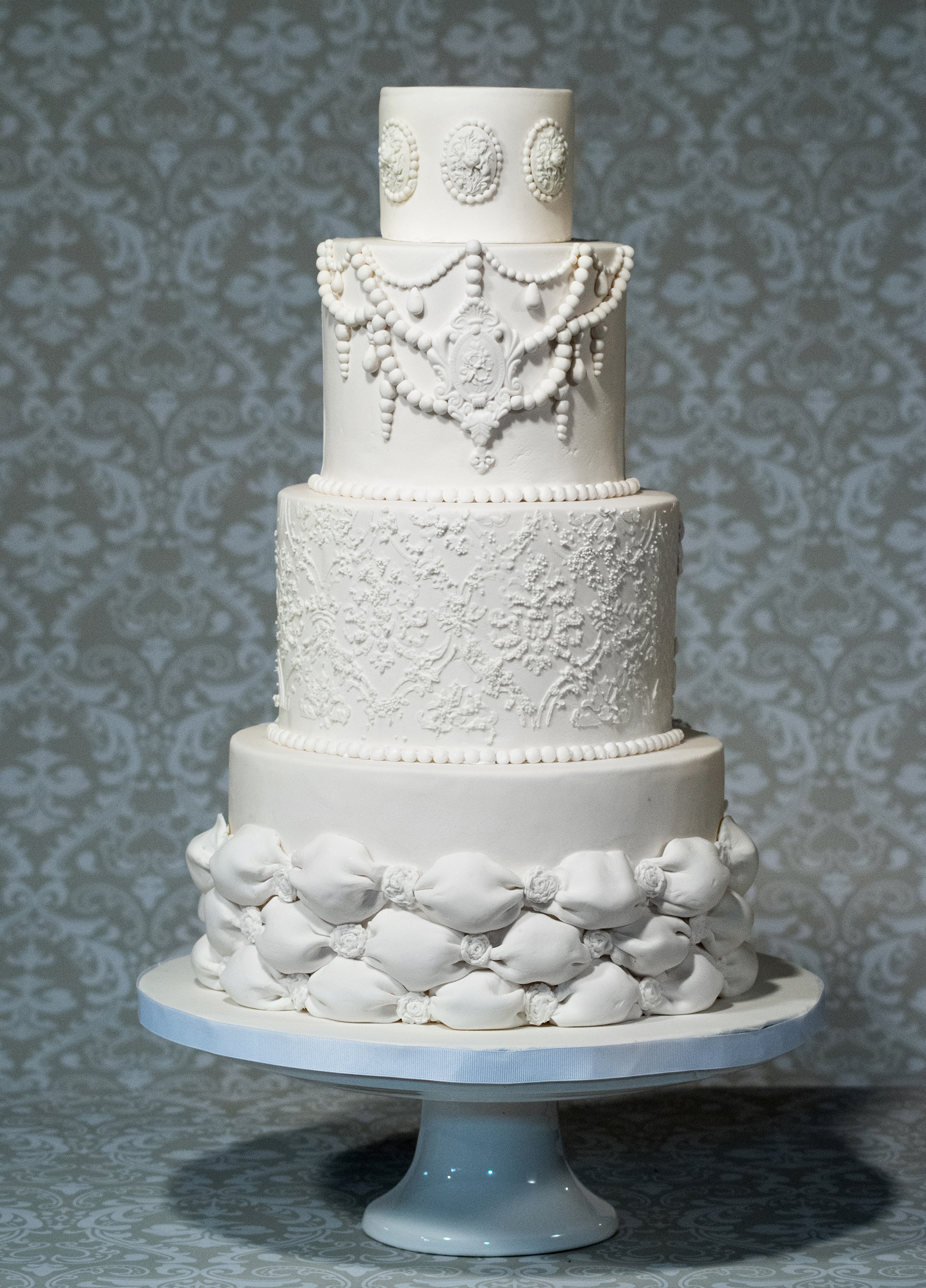 White wedding cake with pearls