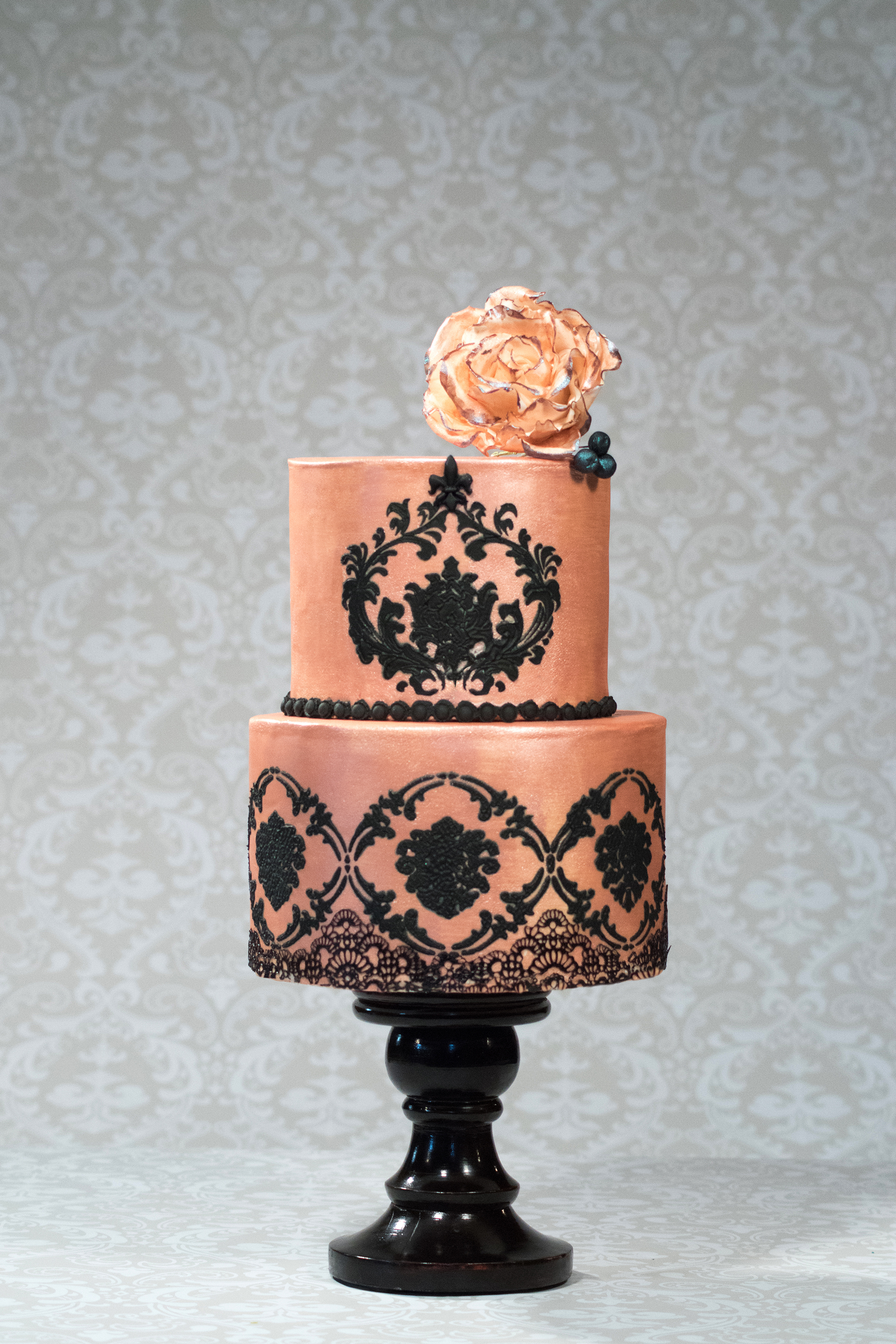 Pink with black lace wedding cake