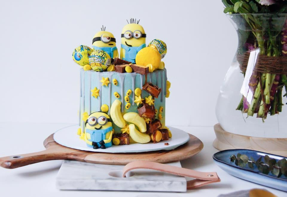 Blue drip cake with minion figurines