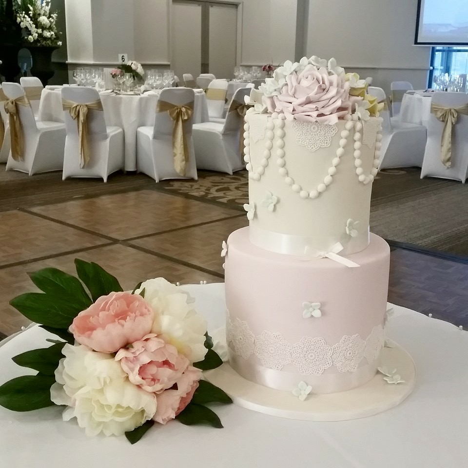 Pink and white pearl wedding cake