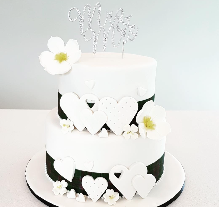 Black and white fondant cake with hearts
