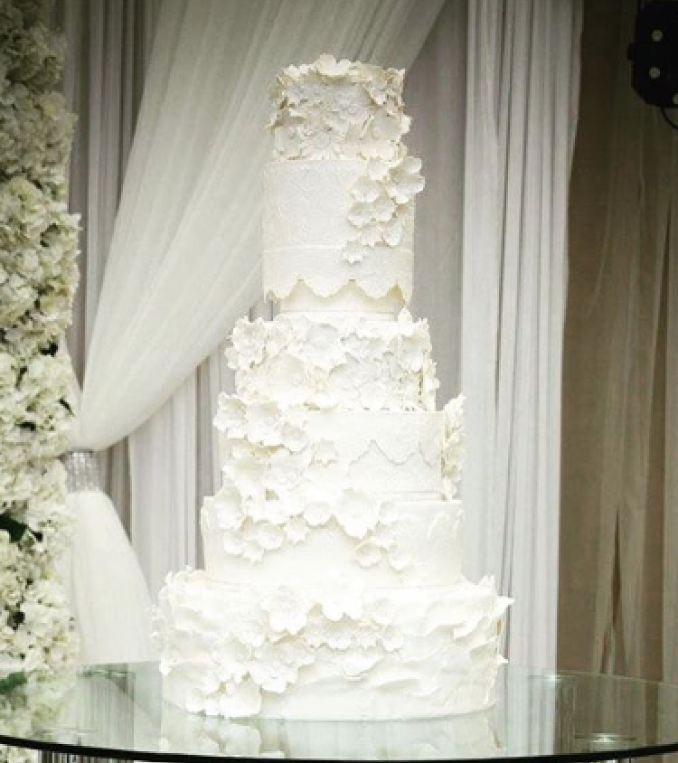 All white fondant ruffle wedding cake