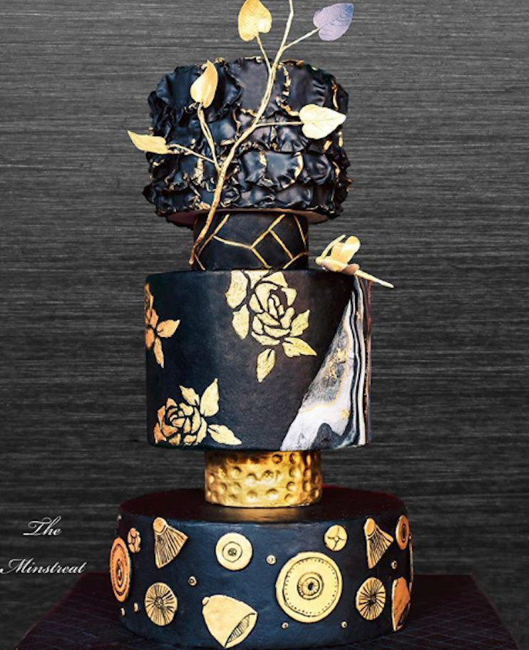 Modern black fondant wedding cake with gold details