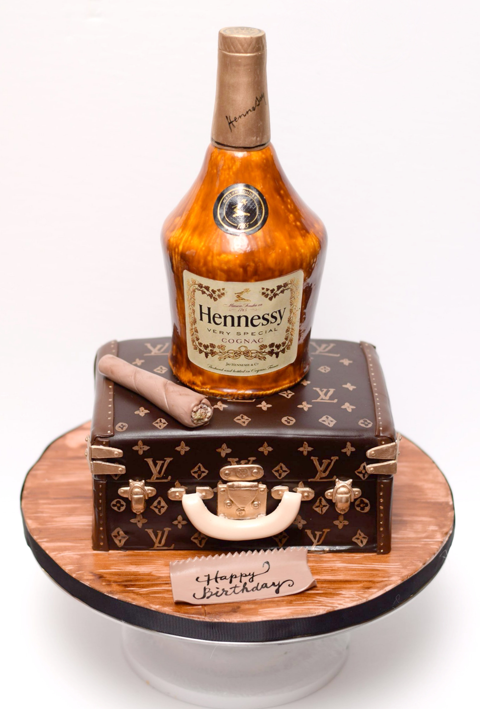 Whiskey bottle shaped fondant birthday cake