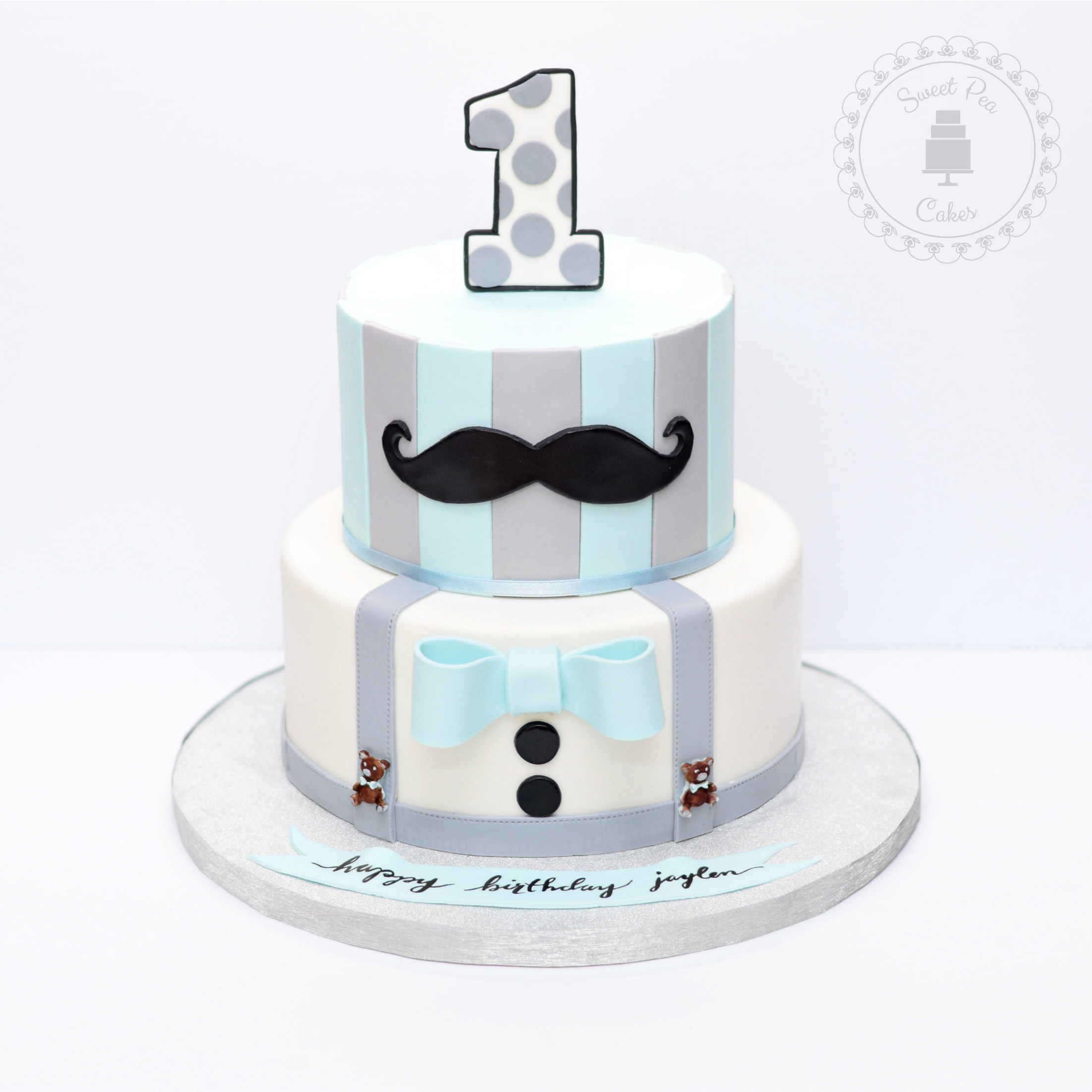 Blue and white striped mustache 1st birthday fondant cake