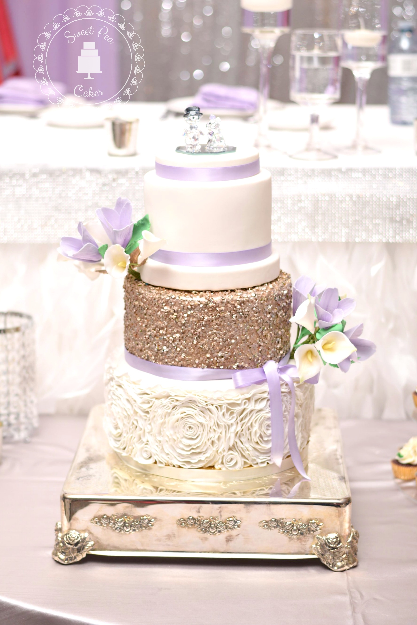 Gold sparkle wedding cake with rosettes