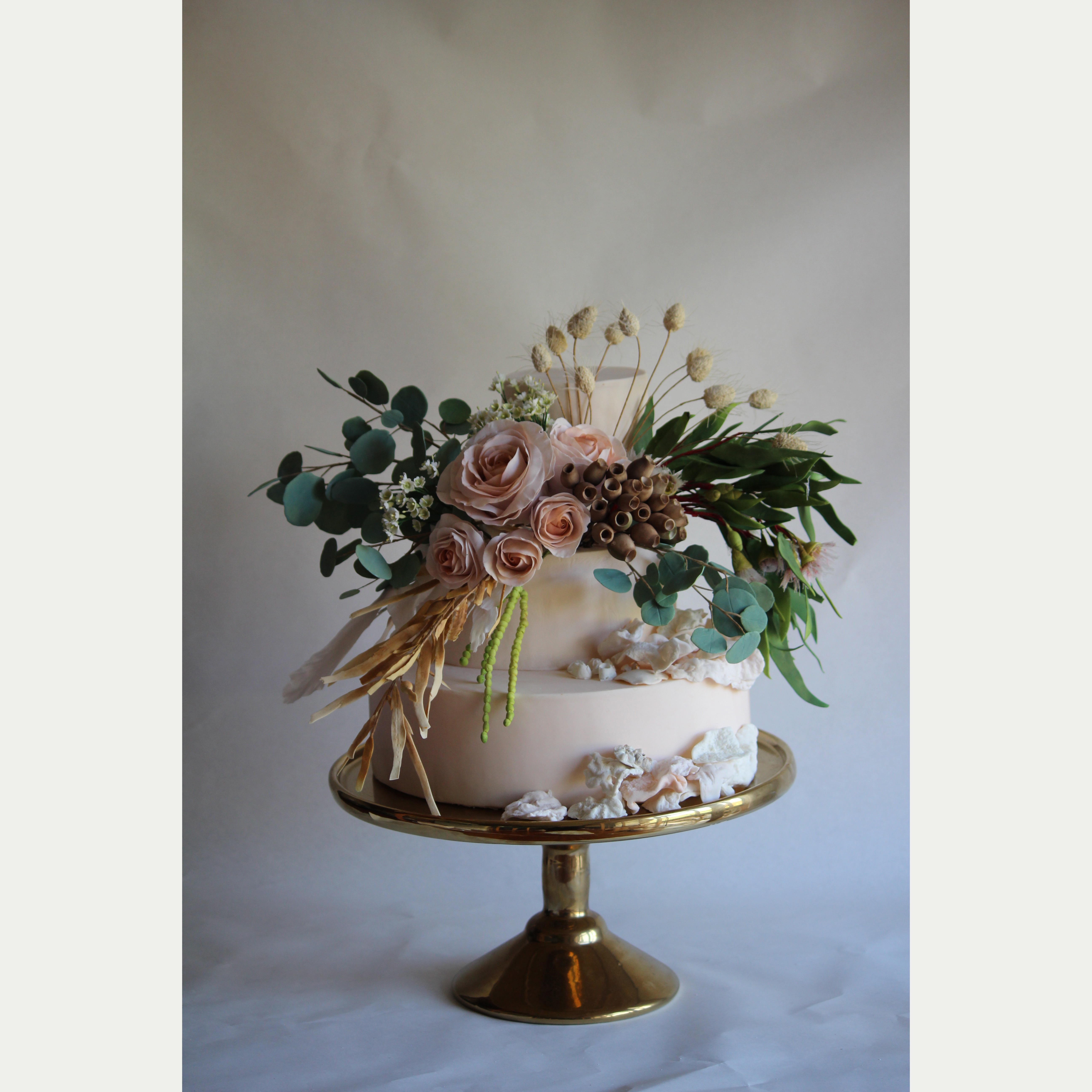 Victorian cake with blush sugar roses and eucalyptus