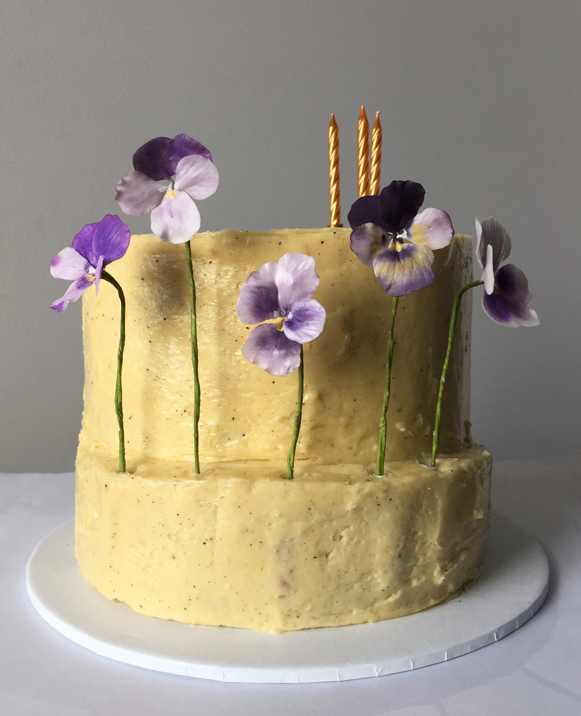 Yellow cake with purple sugar lilacs