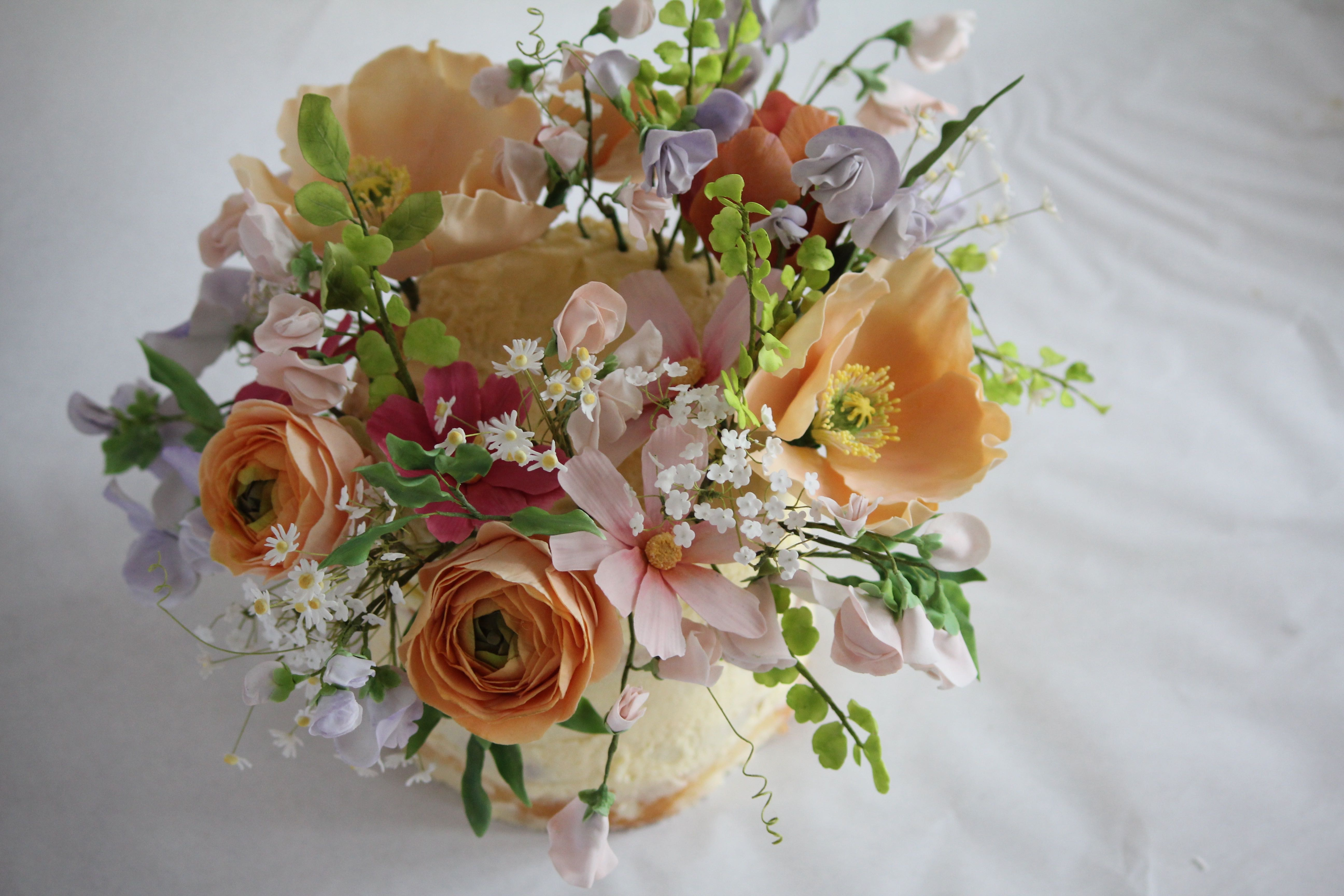 Sugar flower bouquet with peonies and poppies