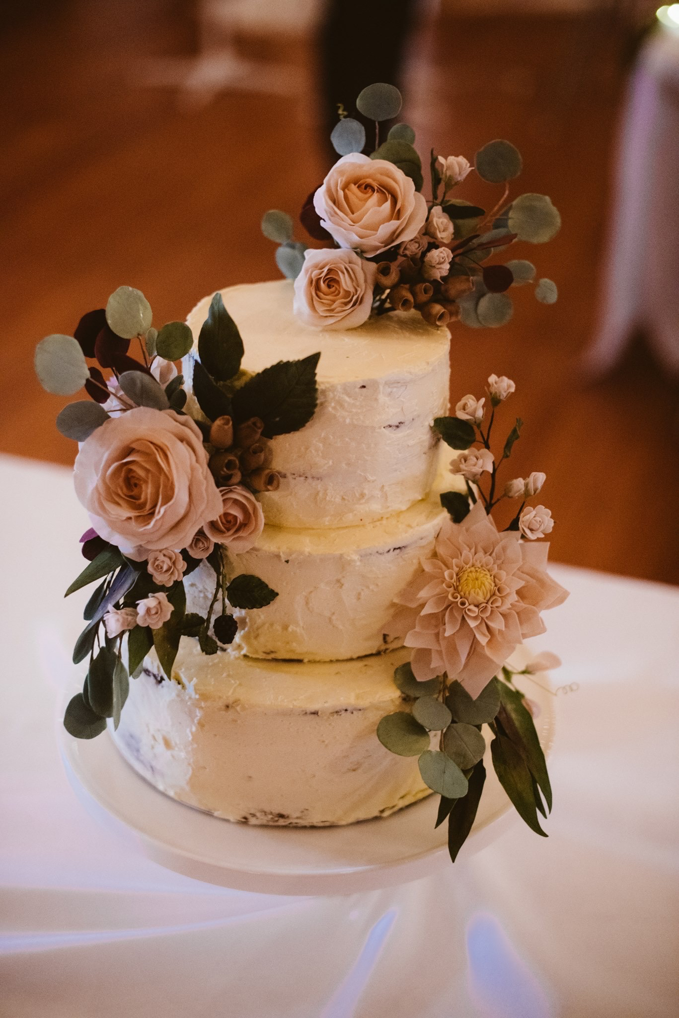 Naked cake with pink sugar roses