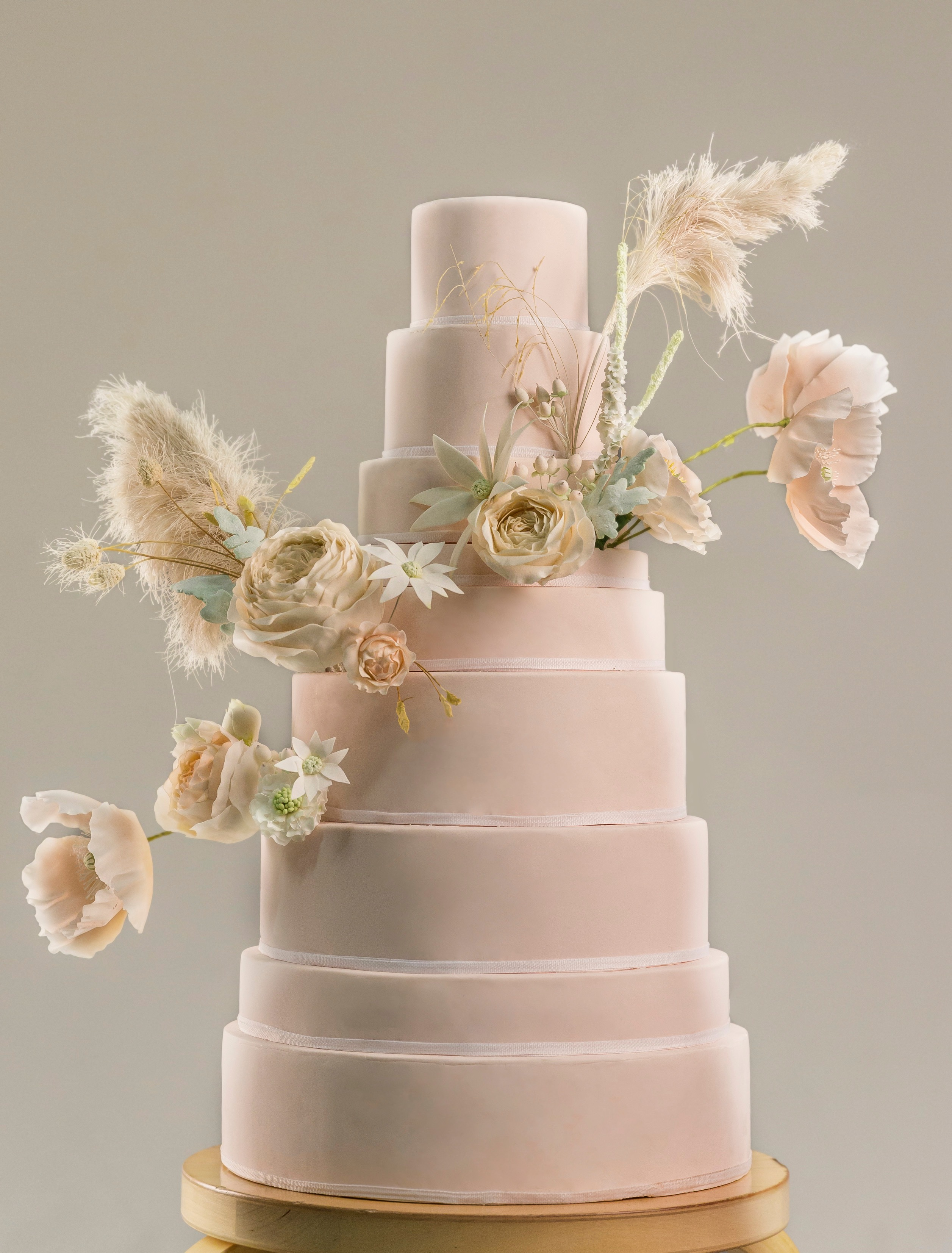 Pink wedding cake with dusty pink sugar roses