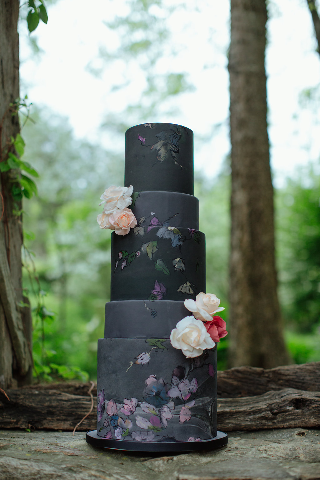 Black wedding cake with blush hand painted flowers