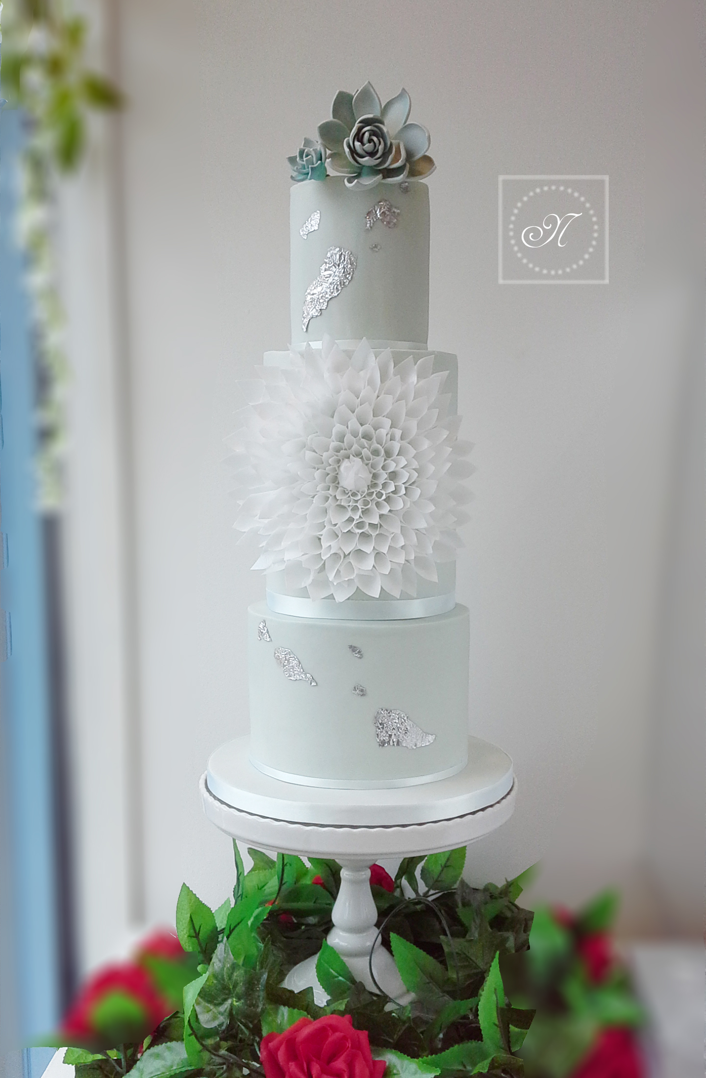 All pastel green fondant wedding cake with white trim