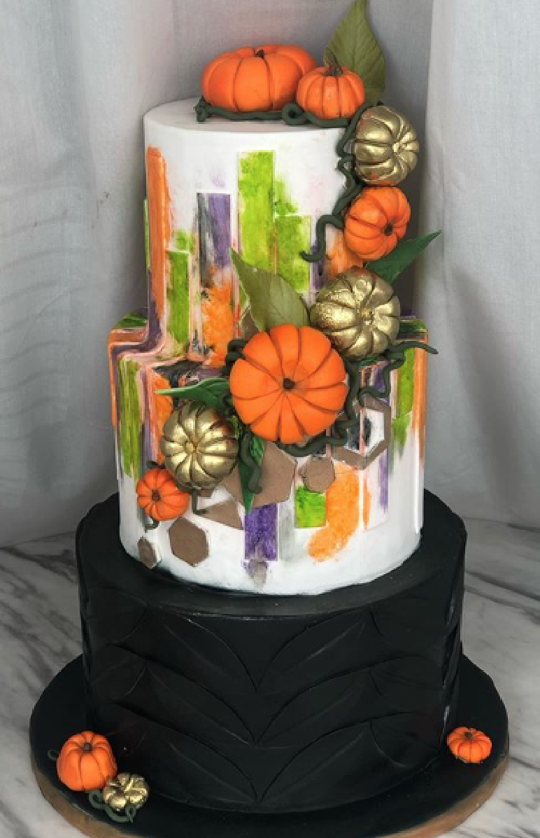Black and white cake with cascading pumpkins