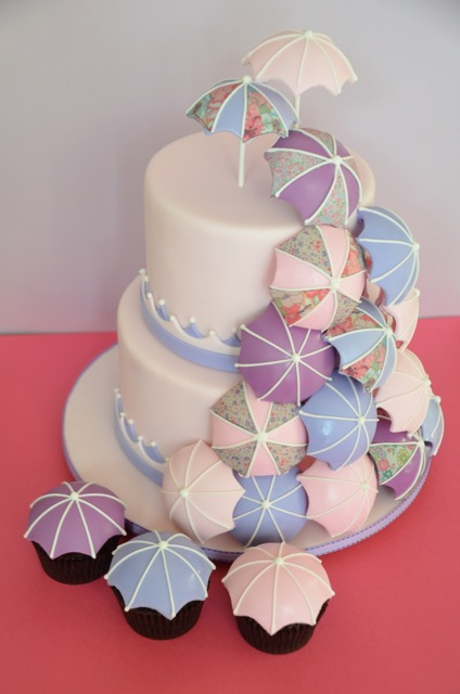 Pink and white umbrella baby shower cake