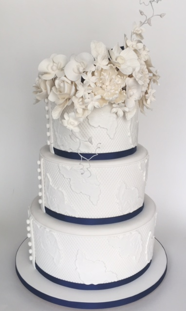 White wedding with white sugar flower bouquet