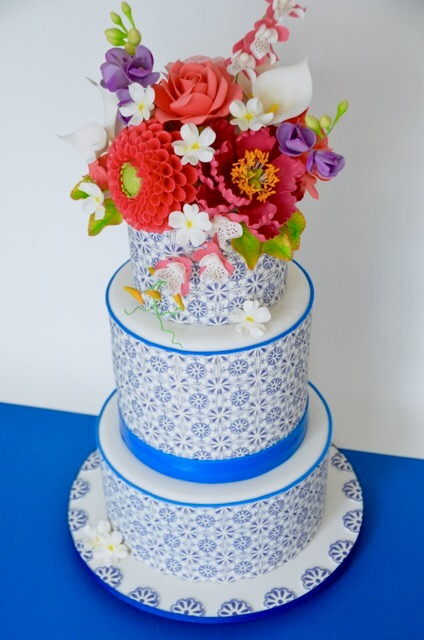 White and blue wedding with sugar flower bouquet on top