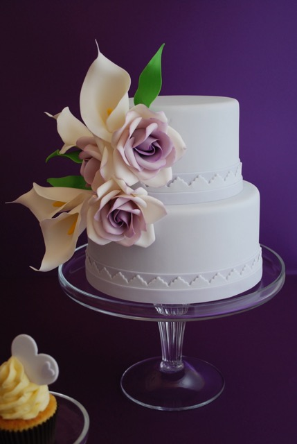 White wedding with purple sugar roses