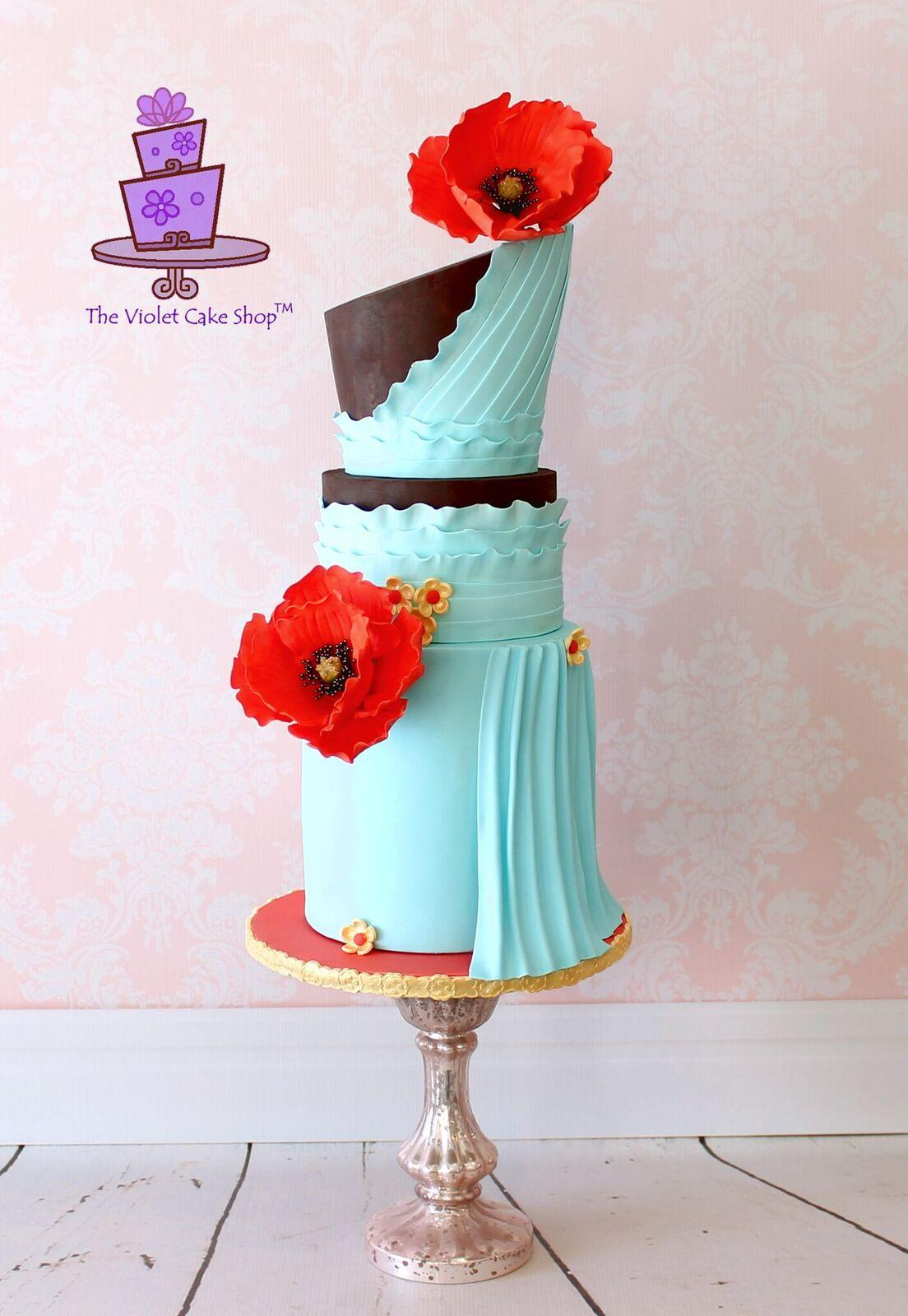 Draped turquoise fondant cake with red poppies