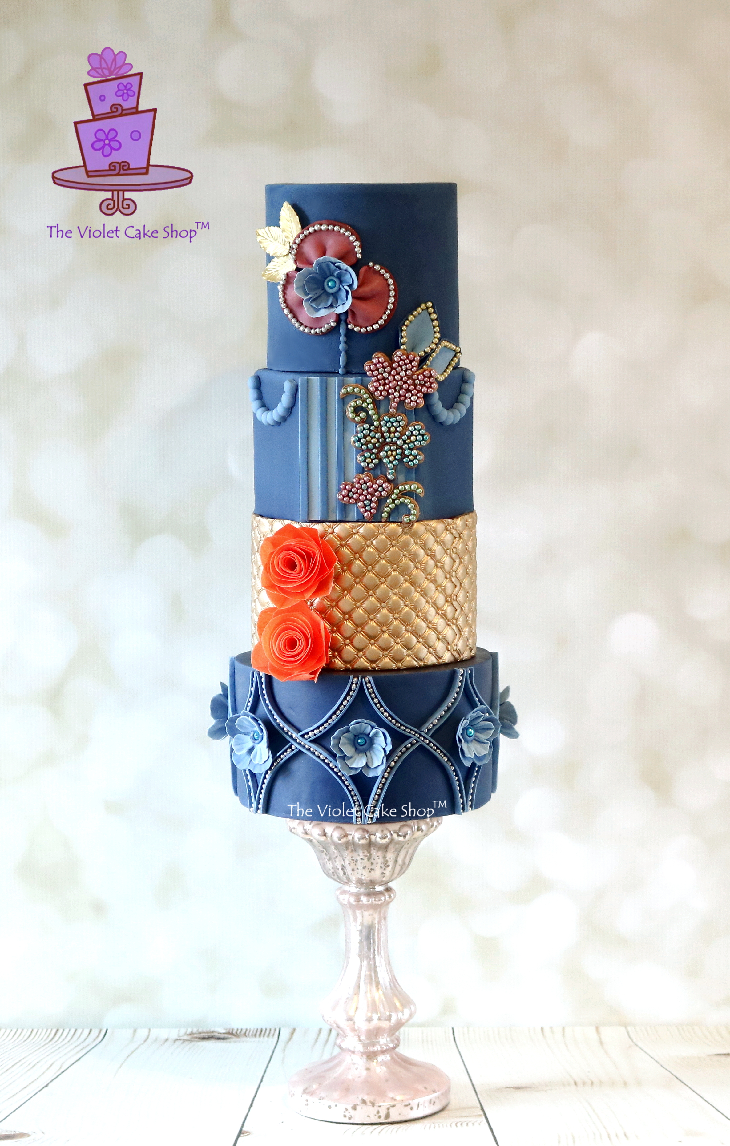 Navy blue and gold elegant fondant wedding cake